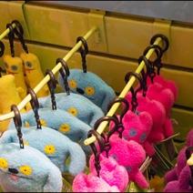 Yellow Hooks on Yellow Slatwall