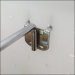 Chrome Flatback Display Hook on Plastic Pegboard CloseUp