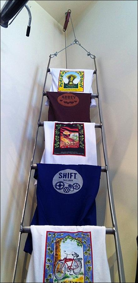 Laddered T Shirt Merchandising Fixtures Close Up