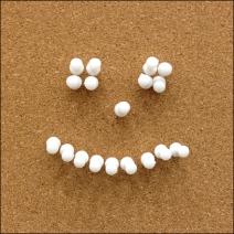 Cork Board Smiley Thumbtack Closeup