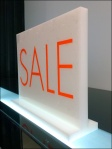 Karen Millen Bottom-Lit Sale Sign Closeup