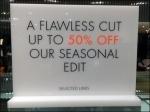Karen Millen Unlit Sale Sign CloseUp