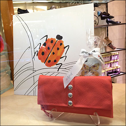 LadyBug Retail Good Luck Purse Visual Merchandising