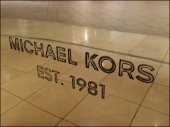 Michael Kors Metal Engraved Closeup