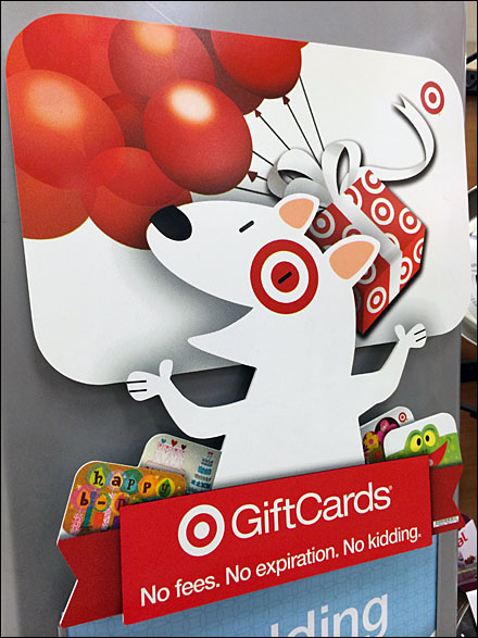 Target mascot juggles cards fixtures close up What kind of dog is the target mascot