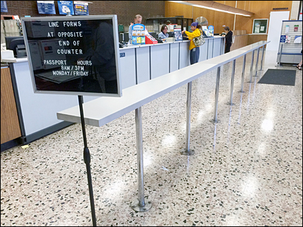 USPS Line Forms At Opposite End Of Counter