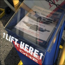 Costco Outdoor Auto Sales Literature Rack Closeup