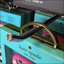 Kate Spade Gold Package Hangs Feature